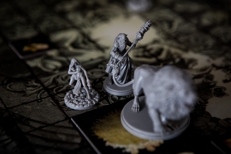 Kingdom Death Monster attacking the lion but failing