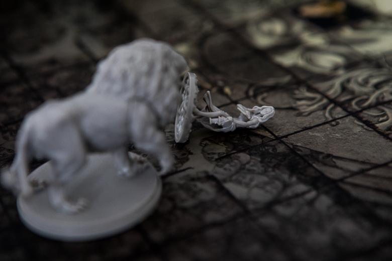 Kingdom Death Monster lion grasp and drag survivor