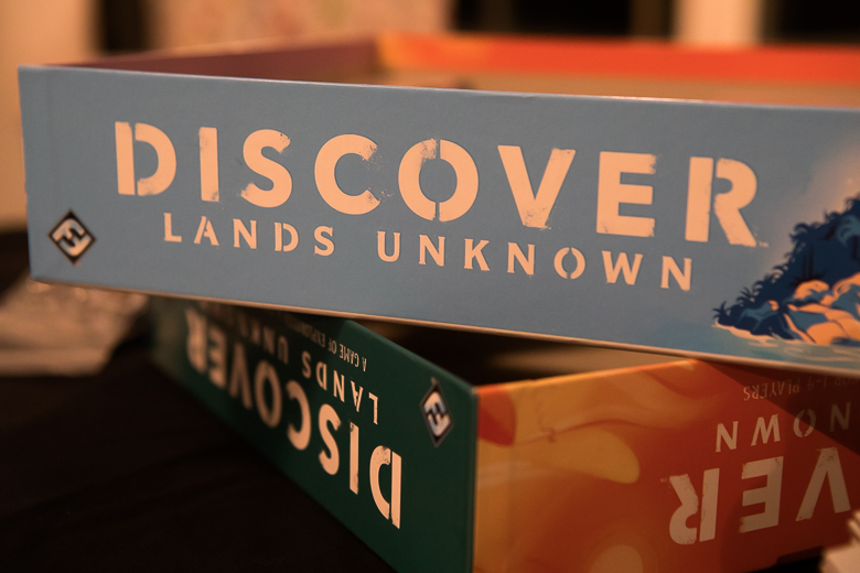 Discover Lands Unknown boxes stacked