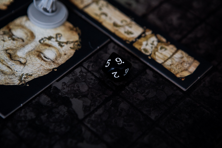 Kingdom Death Monster rolling a 9 from a stone face