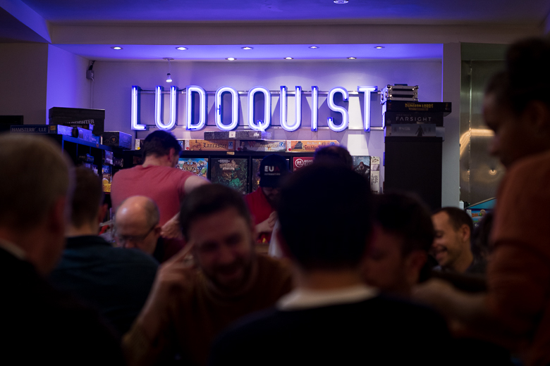 The Ludoquist crowd and logo